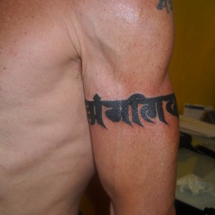 Nepalese test tattoo armband in black ink