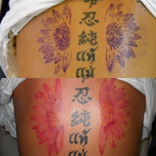 Half lotus tattoo with Chinese and Thai text inside