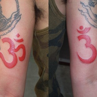 Aum sanskrit writing tattoo in red ink