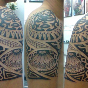 Custom drawn tribal tattoo done in Chiang Mai, Thailand.