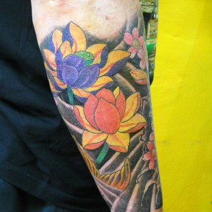 Japanese style tattoo sleeve with traditional Japanese lotus flower motifs