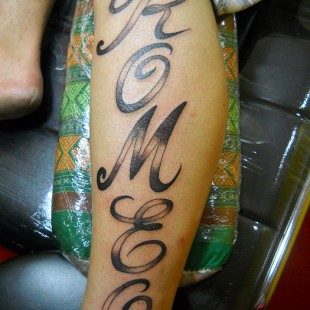 Romeo stylized text tattoo