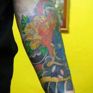 Japanese floral half arm sleeve tattoo