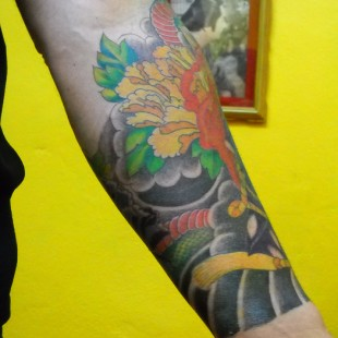 Japanese style tattoo partial sleeve with floral motif