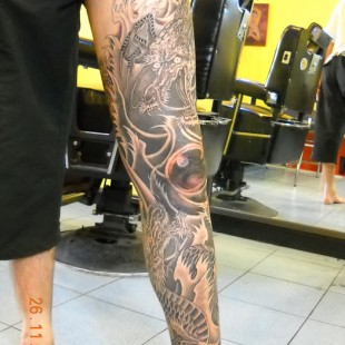 Japanese dragon full leg tattoo on black and grey ink