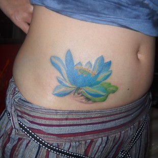 Open lotus tattoo on customer's side