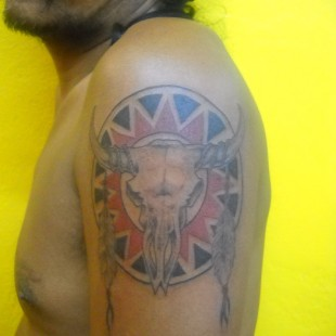 Indian tattoo design with cattle skull and horns