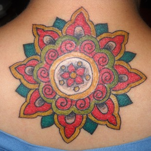 tribal sun tattoo with flowers in color