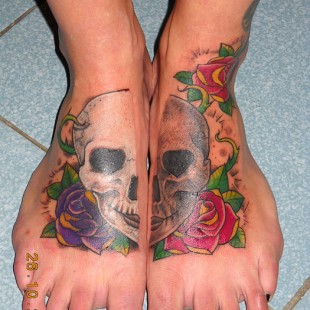 two sided skull tattoo on feet